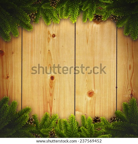 Abstract christmas backgrounds with noel decorations and old wooden desk - stock photo