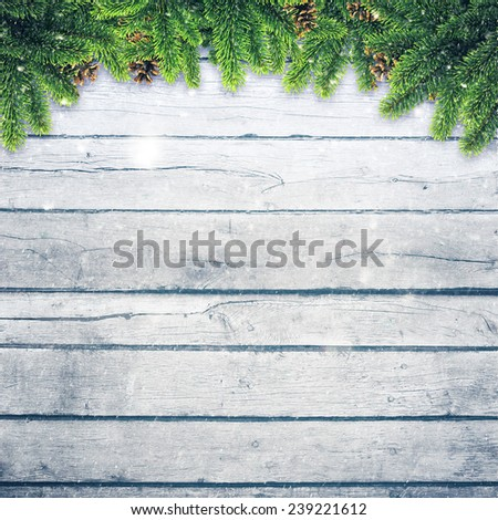Abstract christmas backgrounds with xmas decorations over old wooden desk - stock photo