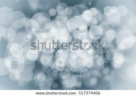 Abstract Christmas blue background concept with snowflakes and sparkles