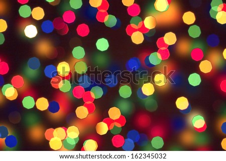Abstract christmas bokeh lights as background on black  - stock photo