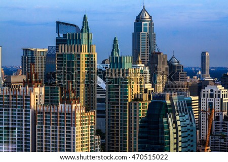 Abstract city blur Bangkok Cityscape  . Panoramic and perspective view light blue background of glass high rise building skyscraper commercial of future. Business success industry tech.