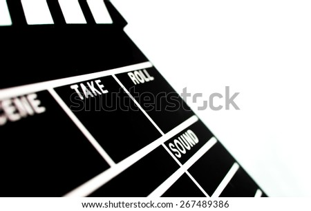 Abstract Clapperboard shallow depth isolated on white background - stock photo