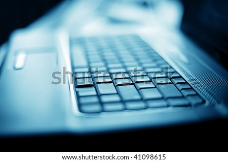 Abstract close-up laptop with shallow DOF - stock photo