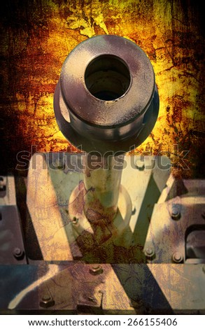 abstract close up of a military tank in camouflaged colors down the barrel - stock photo