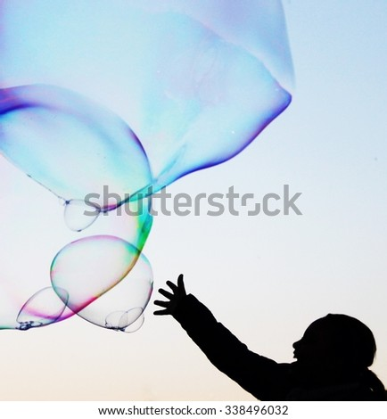abstract close-up soap bubble background modern hand reach simple design with copyspace - stock photo