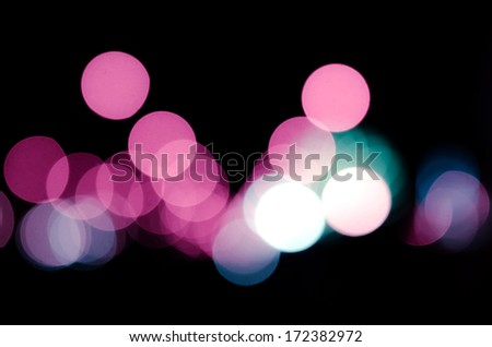 Abstract colorful circular bokeh against a dark background for use at graphic design. - stock photo