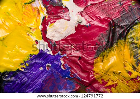 Abstract colorful dry acrylic paint on plate. - stock photo