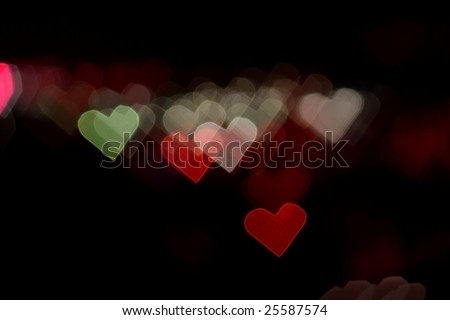 Abstract colorful heart bokeh background - stock photo