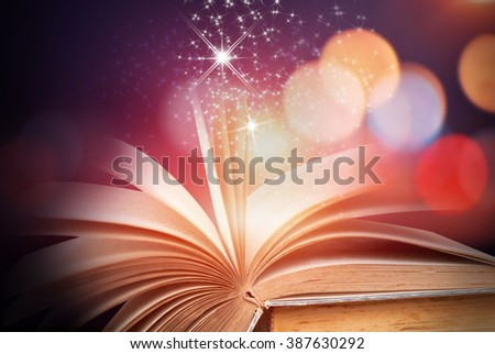 Abstract colorful magic book on wooden background - stock photo