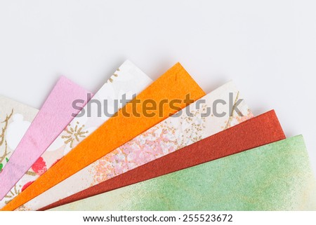 Abstract colorful origami paper pattern texture stacked layer respective, on white background