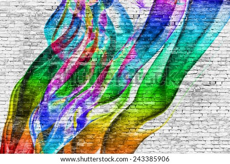 abstract colorful painting over white brick wall - stock photo