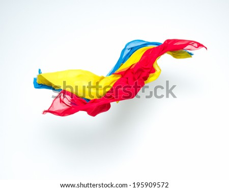 abstract colorful pieces of fabric flying, studio shot, design element - stock photo
