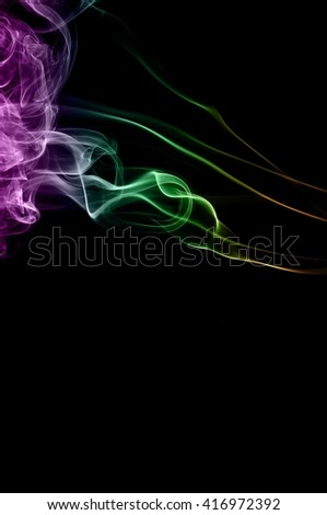 Abstract colorful smoke on black background, color background,colorful ink background,Violet, Green, Orange