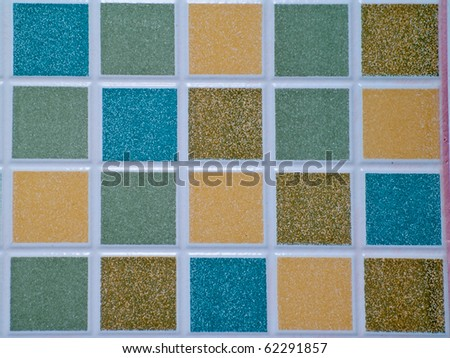 Abstract colorful square block mosaic tile on wall - stock photo