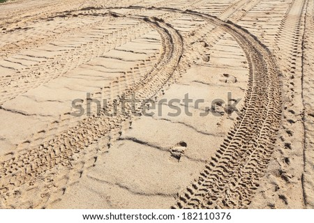 abstract composition for tracks on sand from tire  - stock photo