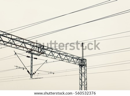 Abstract composition of railway electric wires.