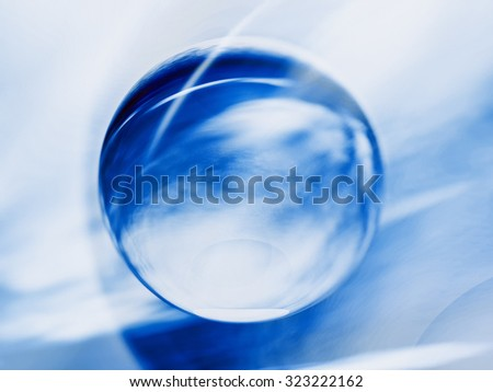 abstract composition, transparent sphere on cloudy background