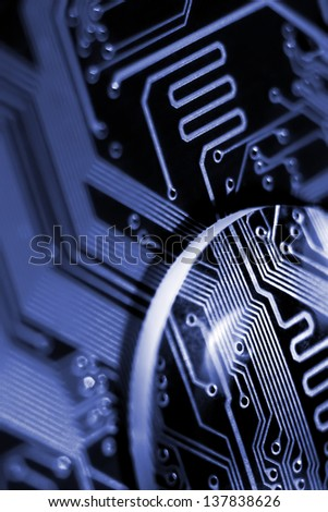 Abstract composition with glass lens on printed circuit board.