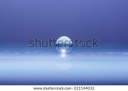 Abstract composition with round glass ball - stock photo