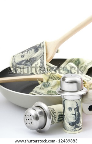 Abstract concept . Fried dollars in frying pan on white background