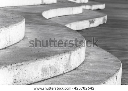 Abstract concrete interior fragment, white curved stairs. Photo with selective focus - stock photo