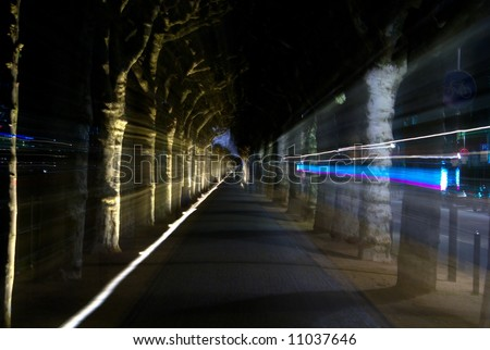 abstract corridor of plane-tree alley - stock photo