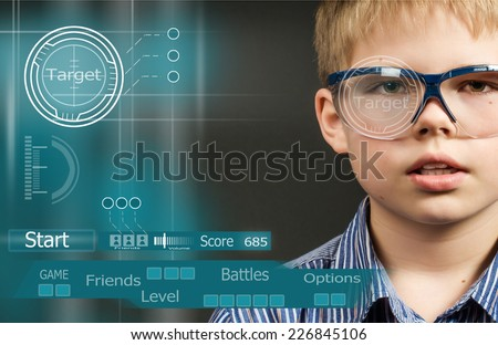 Abstract creative concept of computer virtual game. Gamer boy in virtual glasses near visual screen with game interface. - stock photo