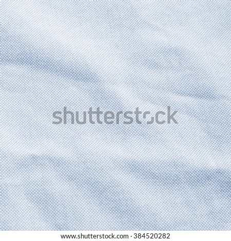 Abstract crumpled blue sapphire color fabric texture background:rough/creased fabric textures in vintage color.wrinkle fabric burlap backdrop concept.garment textile wallpaper:square frame - stock photo