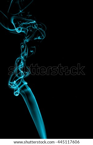 Abstract cyan smoke on black background from the incense sticks