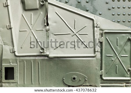 Abstract dark green industrial metal background texture with manholes, details of Russian armored train from WWII time - stock photo