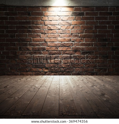 Abstract dark interior background with wooden floor and red brick wall with spot light illumination - stock photo