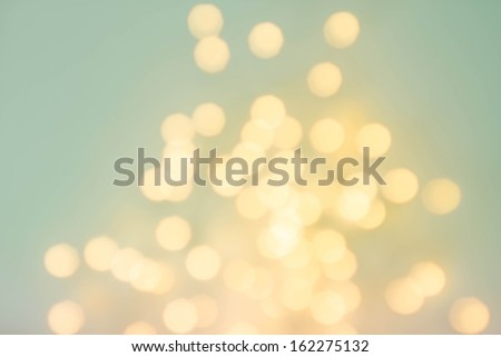 Abstract de focused lights bokeh background with glowing magic gold bokeh. High Resolution retro style - stock photo