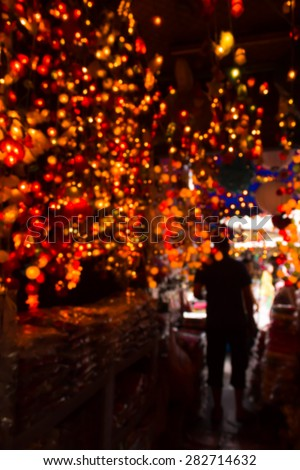 abstract de focused ,Silhouette man with colorful christmas lights on background  - stock photo