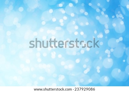 Abstract defocused blue sparkles background