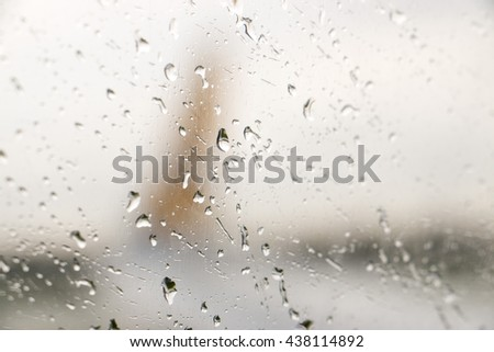 Abstract defocused  of airplane at airport gate with sun coming out after the rain - Travel concept and wander lifestyle at sunset - Focus on raindrops. - stock photo