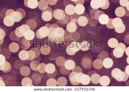 Abstract defocused violaet sparkles background - stock photo