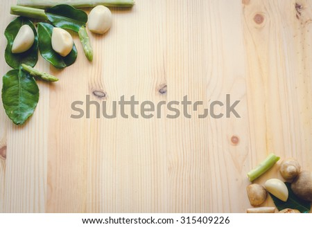 abstract design background vegetables on a wooden background. vintage tone - stock photo