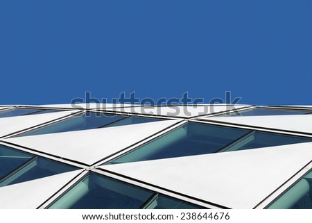 Abstract detail of an oval shaped glass and steel construction building. - stock photo