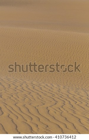 Abstract Detail Of Maspalomas Sand Dunes During Sunrise - Maspalomas, Gran Canaria, Canary Islands, Spain - stock photo