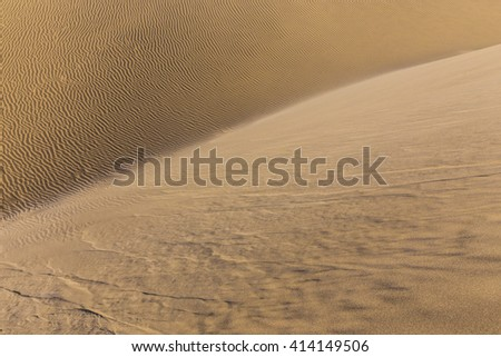 Abstract Detail Of Sand Dunes During Sunrise - Maspalomas, Gran Canaria, Canary Islands, Spain - stock photo
