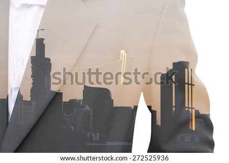 Abstract double exposure between part of business man in suit and cityscape - stock photo
