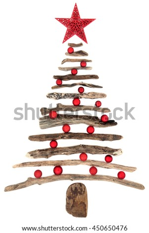 Abstract driftwood christmas tree with red star and bauble decorations over white background. - stock photo
