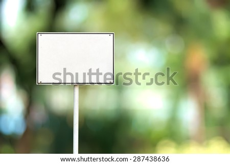 Abstract empty rectangular white sign over blurred public park background - stock photo