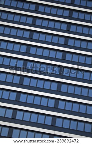 Abstract facade of a modern apartment building - stock photo