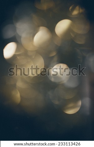 Abstract Festive background. Christmas and New Year feast bokeh background with copyspace. Holiday party background with blurry boke special magic effect. Retro grainy color film look. - stock photo