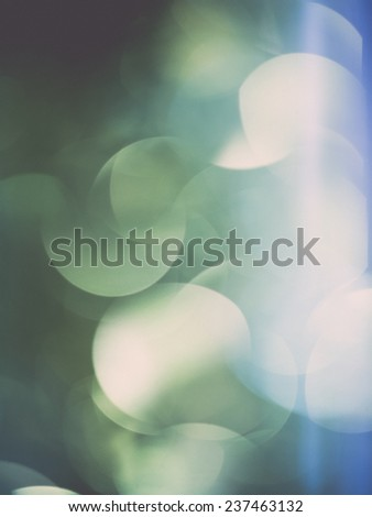 Abstract Festive background. Christmas and New Year feast bokeh background with copyspace. Holiday party background with blurry boke special magic effect. - retro, vintage style look - stock photo