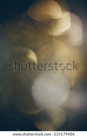 Abstract Festive background. Christmas and New Year feast bokeh background with copyspace. Vintage photography effect. Retro grainy color film look. - stock photo