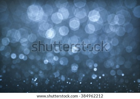 Abstract festive background with diamond bokeh defocused lights from blue color - stock photo