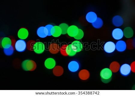 Abstract festive background with photo realistic bokeh defocused lights