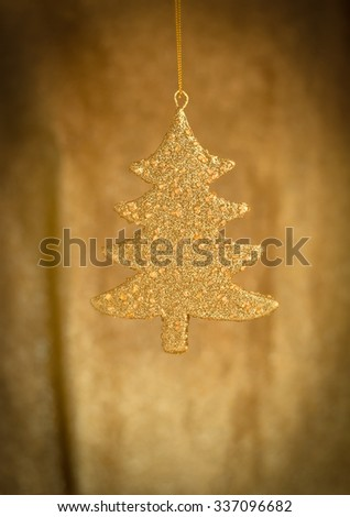 abstract festive tree in the middle with golden background - stock photo
